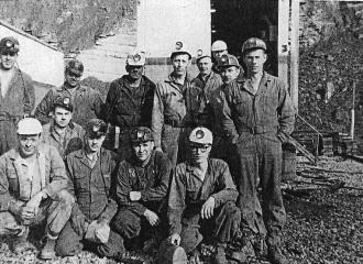 1962 Outside #1 U.G. Mine, Simco-Peabody Coal Co. Front Row L to R = Fred Rice-Boss, Garrett Daniels-Loader Oper., Doyle Rice-Roof Bolter, Evart Ox Caddell-Coal Drill, Chas Mitchell-Loader Oper. Back Row L to R = Troy Sizemore=Repair/Elec., Bud Cornelius-Boss, John Ed Bennett-Repair/Elec.,James Rusty Stunson-Boss, Raymond Bundy-Cutter Oper., James Stewart-Surveyor, Pappy McFarland-Shuttle Car Oper., peeking in the back of truck door way-Drexel Wright.