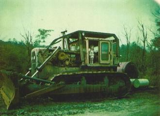 Outside #3 U.G. Mine- Avery Dotson son on dozer used to push coal on pile.