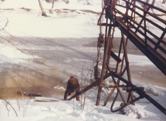 Outside #7 U.G. Mine during blizzard of 1978- Pond that supplied water to the bath house- Bob Green pictured.