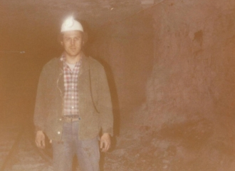 North American Coal Co.-Nov. 1979- Sam Bennett standing on the track entry. Coal Seam height=5 feet high and one foot of rock.