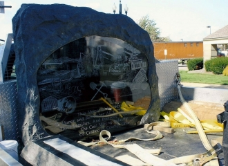 The Memorial Stone on the truck of Milligan Memorials, waiting on the crane to hoist into place. October 18, 2013.