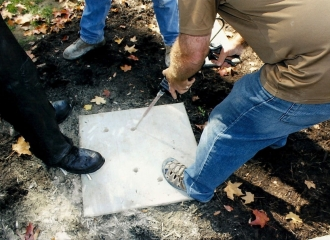 After Alan Cottrill drilled four holes into the cement base, he is filling holes with apoxy glue before placing Bronze Coal Miner Statue in place. October 18, 2013.