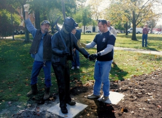 Bronze Coal Miner Statue is sitting flush with the base. Cemented onto base for theft purposes. October 18, 2013.