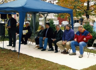 Dedication Ceremony on October 19, 2013, all the speakers sitting up front, waiting to speak. October 19, 2013.