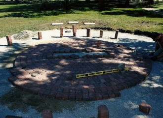 Early stages of brick patio being constructed for the memorial during September 2013.