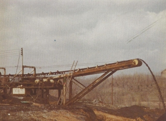Simco-Peabody Coal Co #5 U.G. Mine Outside- Coal mine belt line dumping coal outside of the mine after belt was shortened in 1978.