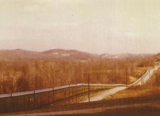 Simco-Peabody Coal Co. #7 U.G. Mine Outside November 23, 1975- Coal belt line leaving the mine and going over to the Simco-Peabody Coal's Surface Mine Belt Line.