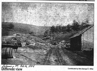 Picture taken out of Coshocton Tribune October 16,1994. Where now you can drive up Sheridan Road and see houses on the left and the right, was once the scene of the Tom Williams Coal Mines. Pictured is the mine entrance in 1901, taken from a view just off of Cambridge Road. Contributor- Mrs. George E. Miller is a resident of Coshocton, Ohio.